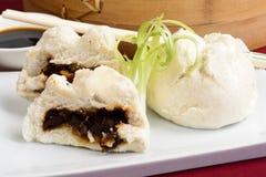 Char Siu Bao. Chinese steamed bun filled with bbq pork - Cantonese Dim Sum Stock Photo