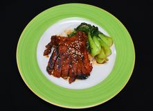 Char siu pork chops with bok choi stock images