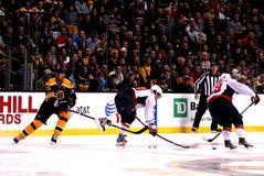 Chara trips Ovechkin (NHL Hockey) Stock Image