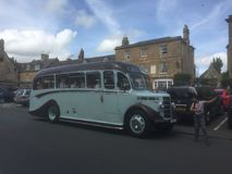 The charabang comes into town. The old bus in the Cotswolds Stock Photos