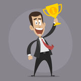 Character businessman winner holds cup Royalty Free Stock Photography