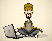 User in gray shirt and cap with a laptop Royalty Free Stock Image