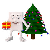 Character beside Christmas tree Royalty Free Stock Photos