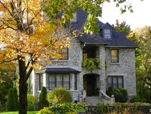 Character home in the Autumn. A attractive looking brick home in Quebec city stock photography