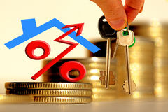 The character of the property and the keys on the background of bars coins . The concept of financial instability on the real estate market Stock Images