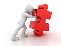 Character pushing the Jigsaw Piece Royalty Free Stock Photo