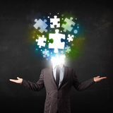 Character in suit with puzzle head concept. Character in suit with glowing puzzle head concept Stock Images