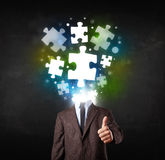 Character in suit with puzzle head concept. Character in suit with glowing puzzle head concept Stock Image