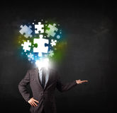 Character in suit with puzzle head concept Royalty Free Stock Photography