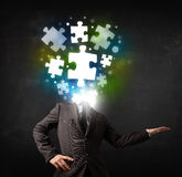 Character in suit with puzzle head concept Royalty Free Stock Photo