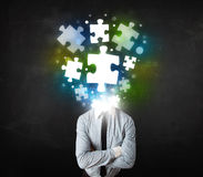 Character in suit with puzzle head concept Stock Photography