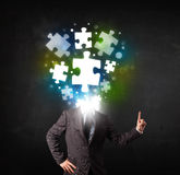 Character in suit with puzzle head concept Royalty Free Stock Image