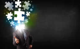 Character in suit with puzzle head concept. Character in suit with glowing puzzle head concept Royalty Free Stock Photo