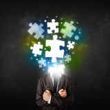 Character in suit with puzzle head concept. Character in suit with glowing puzzle head concept Royalty Free Stock Photos