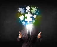 Character in suit with puzzle head concept. Character in suit with glowing puzzle head concept Royalty Free Stock Images