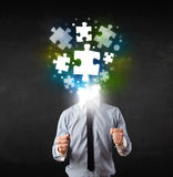 Character in suit with puzzle head concept. Character in suit with glowing puzzle head concept Royalty Free Stock Image