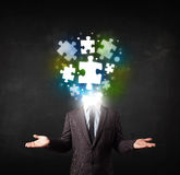 Character in suit with puzzle head concept Royalty Free Stock Images