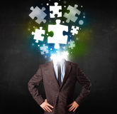 Character in suit with puzzle head concept. Character in suit with glowing puzzle head concept Stock Photo