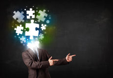 Character in suit with puzzle head concept. Character in suit with glowing puzzle head concept Royalty Free Stock Photography