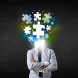 Character in suit with puzzle head concept Stock Images