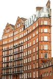 View of typical English building in old red bricks, London. The characteristic Albert Hall Mansions in London. The Mansions are London`s first ever block of Royalty Free Stock Image