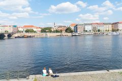 Characteristic architecture and tourist boats alongside promenad. PRAGUE, CZECH REPUBLIC - AUGUST 29, 2017; Characteristic architecture and tourist boats Stock Image