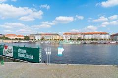 Characteristic architecture and tourist boats alongside promenad. PRAGUE, CZECH REPUBLIC - AUGUST 29, 2017;Characteristic architecture and tourist boats Royalty Free Stock Images