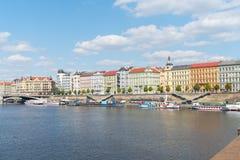 Characteristic architecture and tourist boats alongside promenad. PRAGUE, CZECH REPUBLIC - AUGUST 29, 2017; Characteristic architecture and tourist boats Stock Photos
