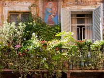 Characteristic balcony in Rome. Balcony in Rome with religious icon and green plants stock photos