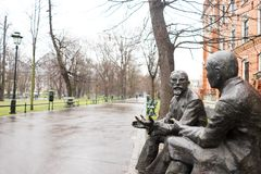 Characteristic bronze sculpture on a bench in Krakow, Poland Stock Photos