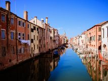 Characteristic canal in Chioggia, lagoon of Venice. Characteristic canal in Chioggia, lagoon of Venice, Italy Royalty Free Stock Images