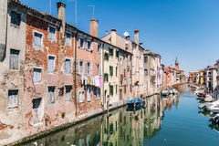 Characteristic canal in Chioggia, lagoon of Venice. stock images