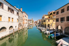 Characteristic canal in Chioggia, lagoon of Venice. Royalty Free Stock Images