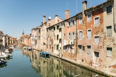 Characteristic canal in Chioggia, lagoon of Venice. Stock Image
