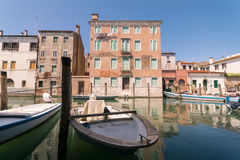 Characteristic canal in Chioggia, lagoon of Venice. Royalty Free Stock Photos