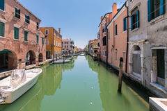 Characteristic canal in Chioggia, lagoon of Venice. Royalty Free Stock Image