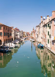 Characteristic canal in Chioggia, lagoon of Venice. Royalty Free Stock Photo