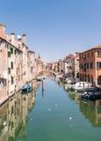 Characteristic canal in Chioggia, lagoon of Venice. Stock Photo
