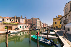 Characteristic canal in Chioggia, lagoon of Venice. royalty free stock photography