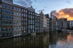 The characteristic canal houses on the Damrak in the old town of. Amsterdam, Netherlands, December 16, 2017:  The characteristic canal houses on the Damrak in Stock Photography