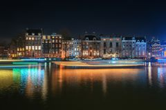The characteristic canal houses and houseboats along the river A. Amsterdam, Netherlands, December 16, 2017:  The characteristic canal houses and houseboats Royalty Free Stock Photo