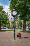 A characteristic clock on a square Stock Image