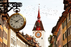 Characteristic clock and tower bell in Bremgarten old town, Switzerland stock photo