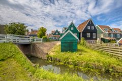 Characteristic Dutch village scene with wooden houses and bridge Stock Photo