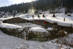 Characteristic farmhouse snowscape Stock Image