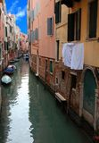 Characteristic glimpse with the navigable canal in the island of. Venice with the boats the clothes of the laundry Stock Photo