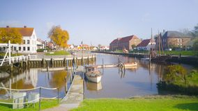 Characteristic harbour at the north sea coast. In germany. Fishing boats and an old wooden bridge royalty free stock photo