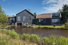 Characteristic house and also bucking in the village De Woude. De Woude, Netherlands, April 30, 2017: Characteristic house iand also bucking n the village De Stock Photography