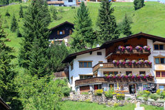 Characteristic house construction in Austria with large balconies and many flowers. Austria is known as one of the best winter sports countries in the world, but Stock Photography