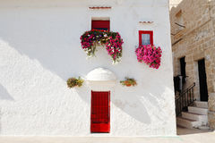 Characteristic house with flowers at the window in Monopoli near Bari, Apulia, Italy Royalty Free Stock Images